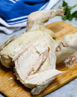 Carving up a whole boiled chicken