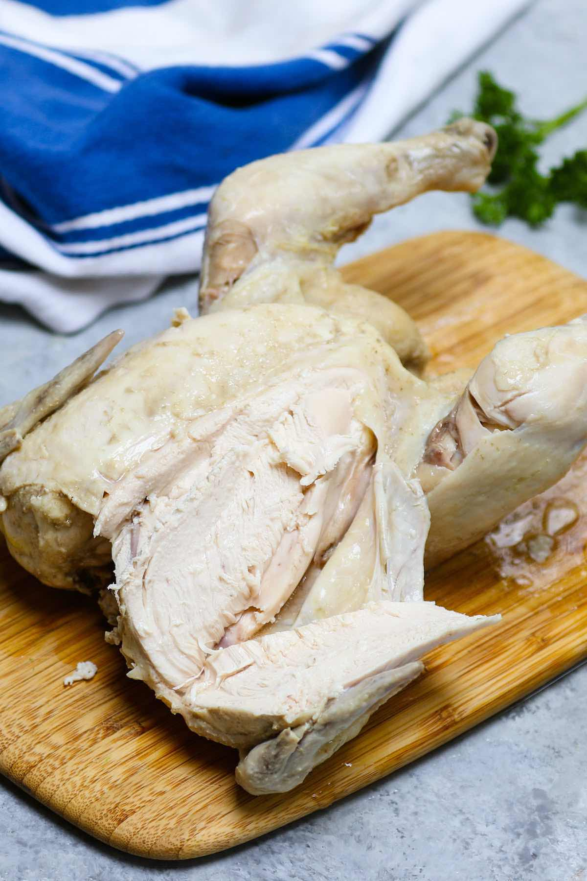 Carving up a whole cooked chicken for use in other recipes
