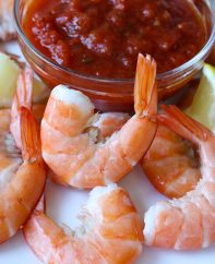 Shrimp cocktail using jumbo shrimp with tails on and boiled briefly to perfect doneness