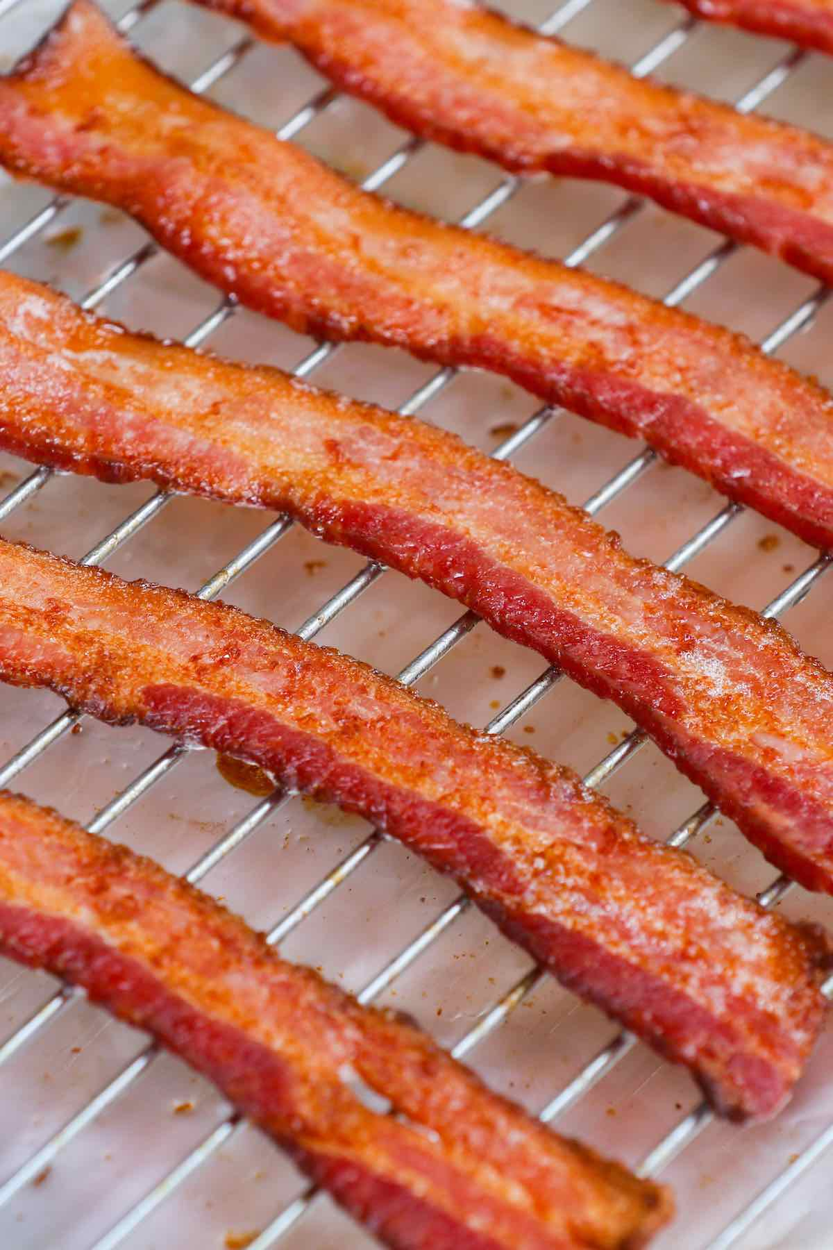 Crispy baked thick-cut bacon on a wire rack.