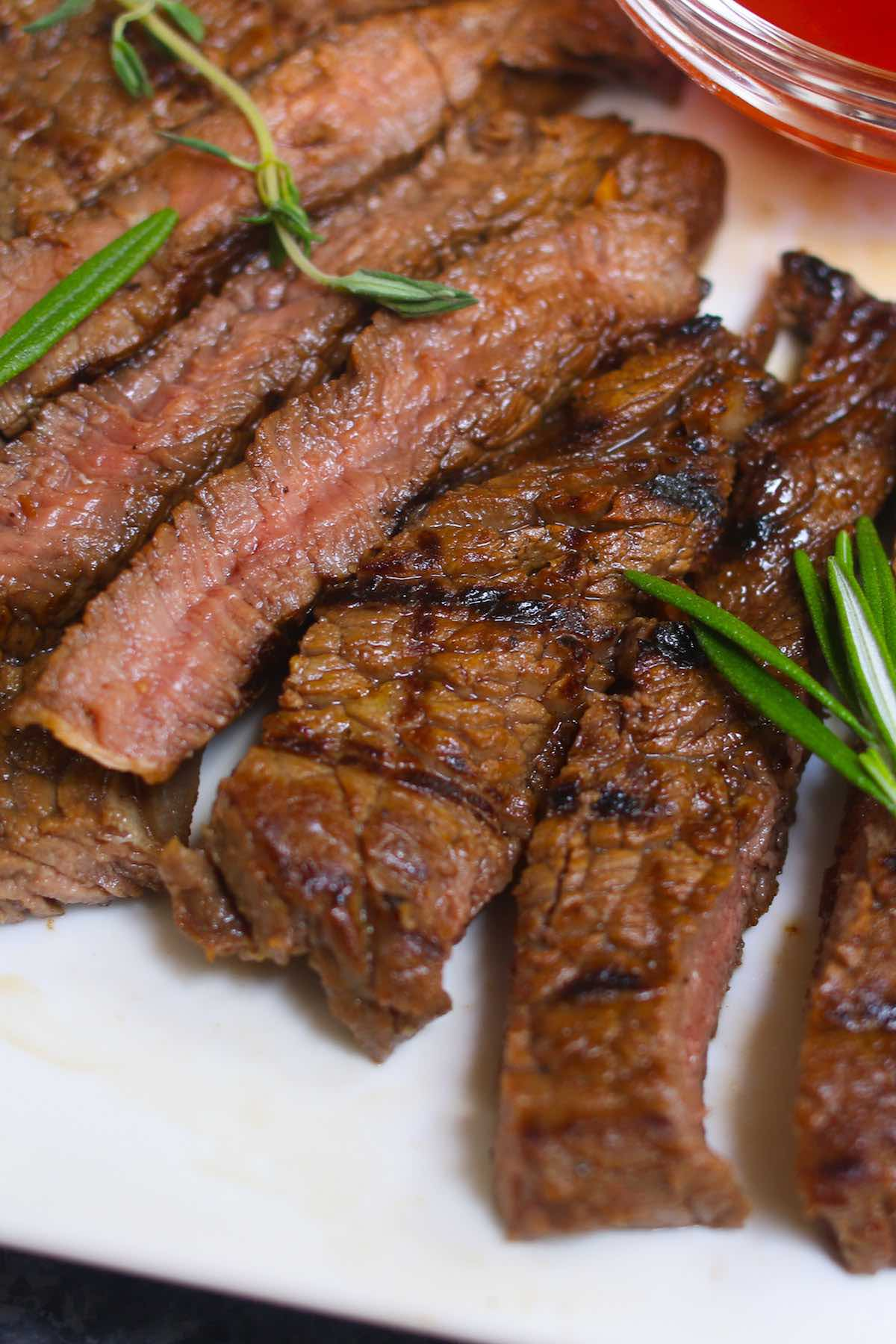 Closeup of perfectly grilled steak with crosshatch grill marks and a tender and juicy interior