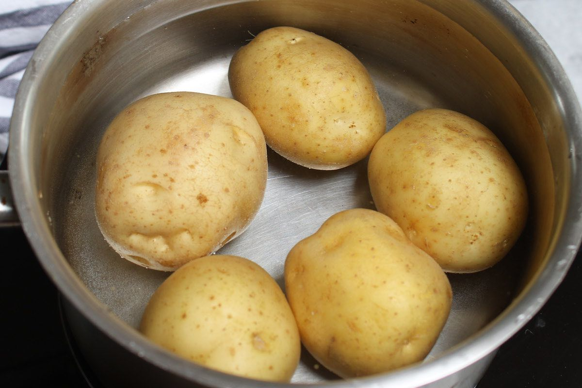 Round white potatoes in a medium pot before adding water for boiling