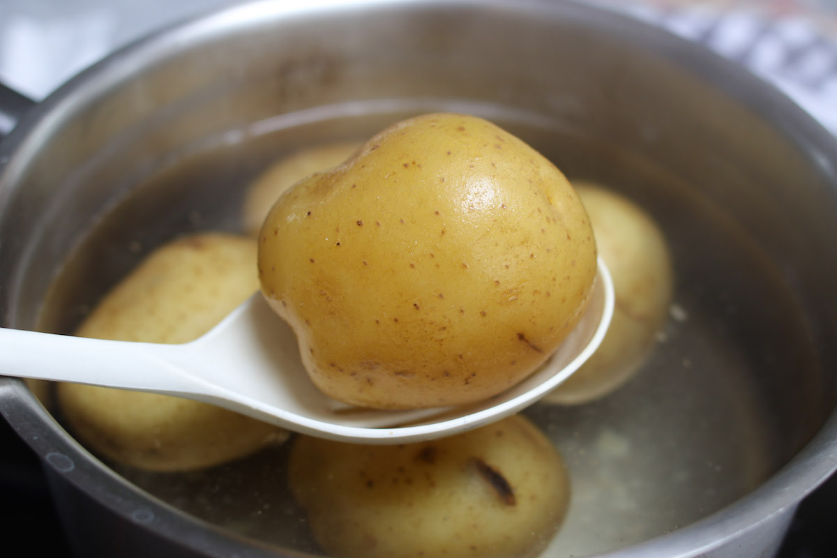 Closeup of a round white potato that has been boiled until tender
