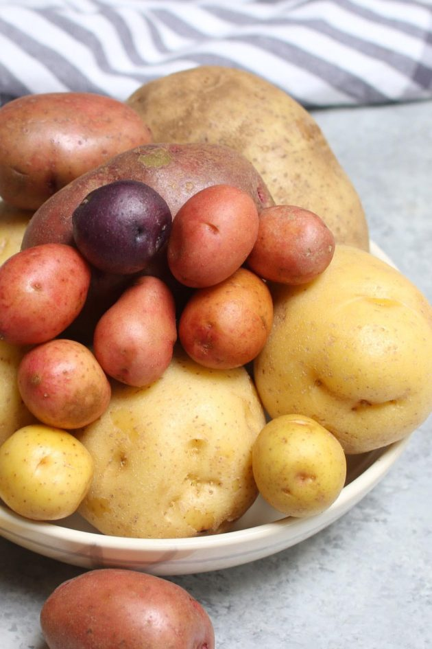 Different types of spuds including red, white, purple and russet