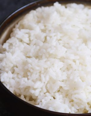 Fluffy microwave rice in a serving bowl ready to combine with other dishes to make a delicious meal