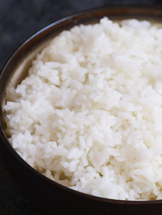 A bowl of microwave white rice showing fluffy texture of the grains for an easy side dish that's ready in minutes