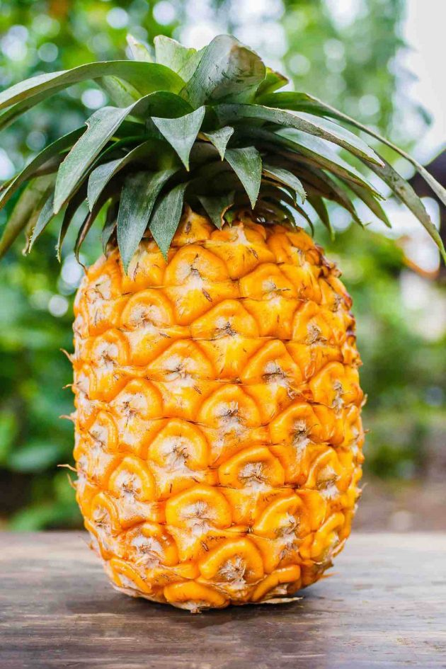 A ripe pineapple with golden colored flesh