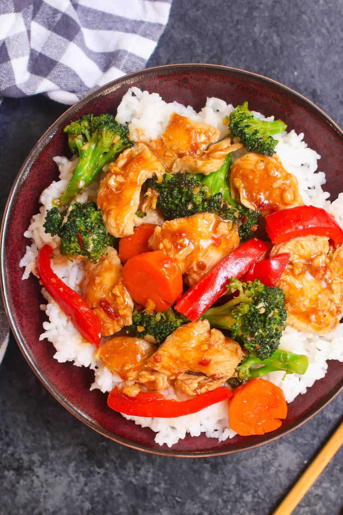Hunan Chicken is a spicy stir-fry dish with sliced chicken breast and mixed vegetables in a delicious Hunan sauce. The spicy chili bean paste lends a wonderful salty and spicy flavor to this quick and easy recipe that rivals authentic Chinese takeout.