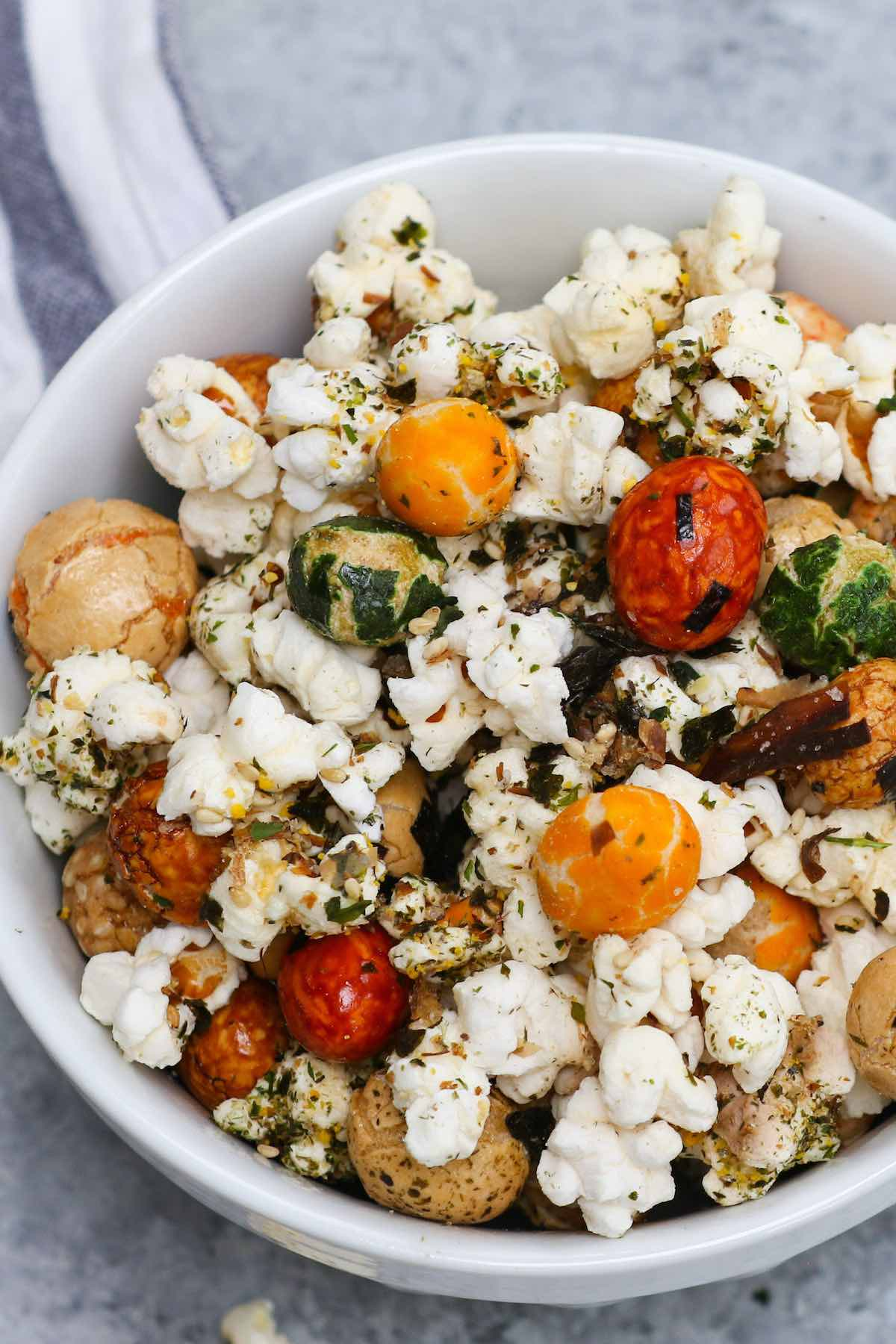 Are you looking for the perfect at-home movie snack? Look no further than Hawaiian Hurricane Popcorn. This easy treat is crunchy and buttery, with a bit of sweetness. Made with popcorn kernels, Japanese rice crackers, and furikake, this easy stove-top recipe is so much better than microwave popcorn and it takes less than 10 minutes to make! #HurricanePopcorn #HawaiianHurricanePopcorn