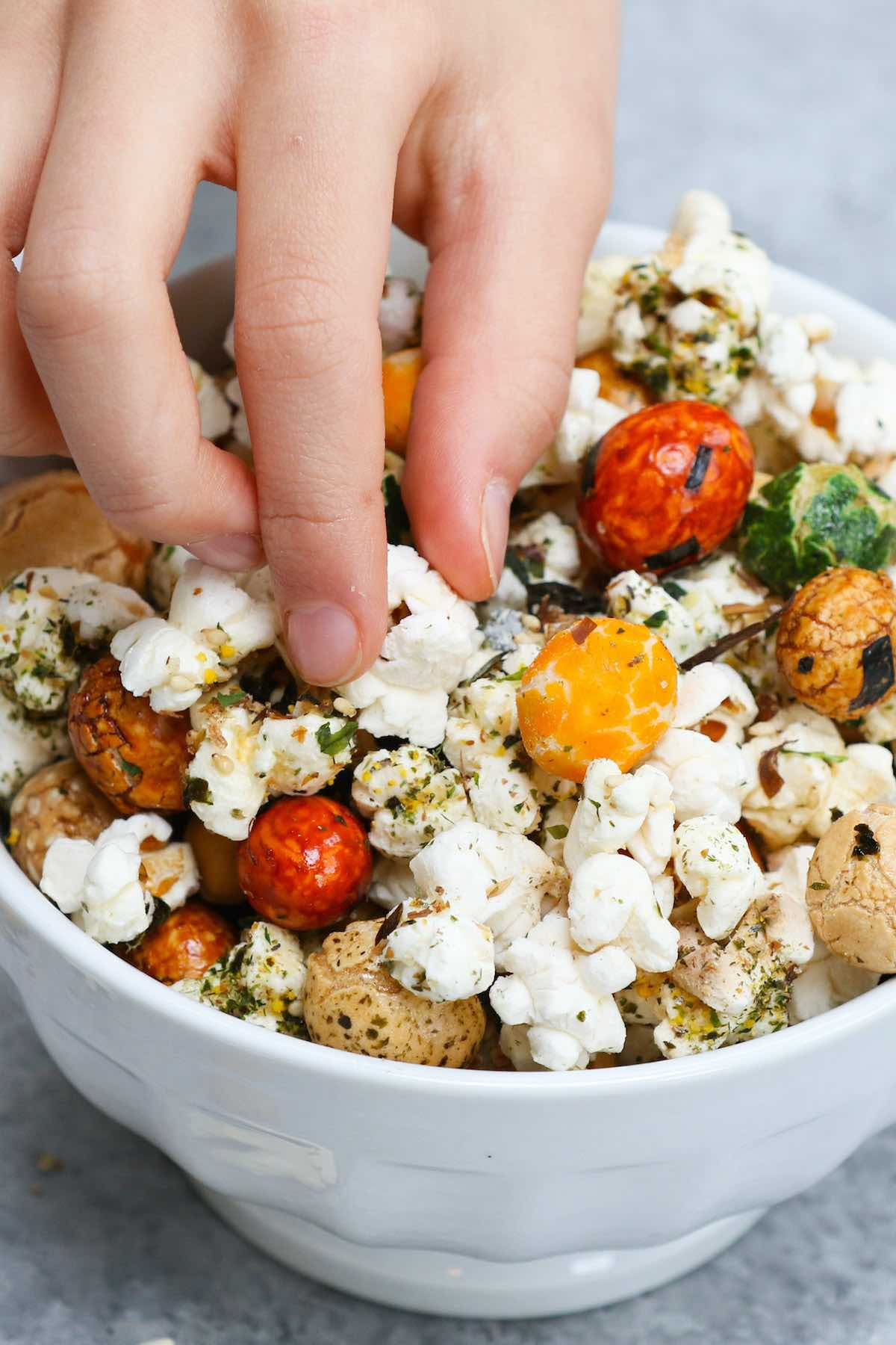 A colorful serving bowl full of Hawaiian popcorn #HurricanePopcorn #HawaiianHurricanePopcorn