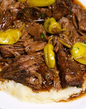 Instant Pot Mississippi Roast is a comforting dinner that even picky eaters will devour. The chuck roast is fall-apart tender with a flavorful gravy.