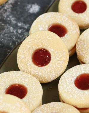 These soft and buttery homemade Jammie Dodgers are a UK staple! They are two shortbread biscuits sandwiched together with fruity jam such as strawberry or raspberry.
