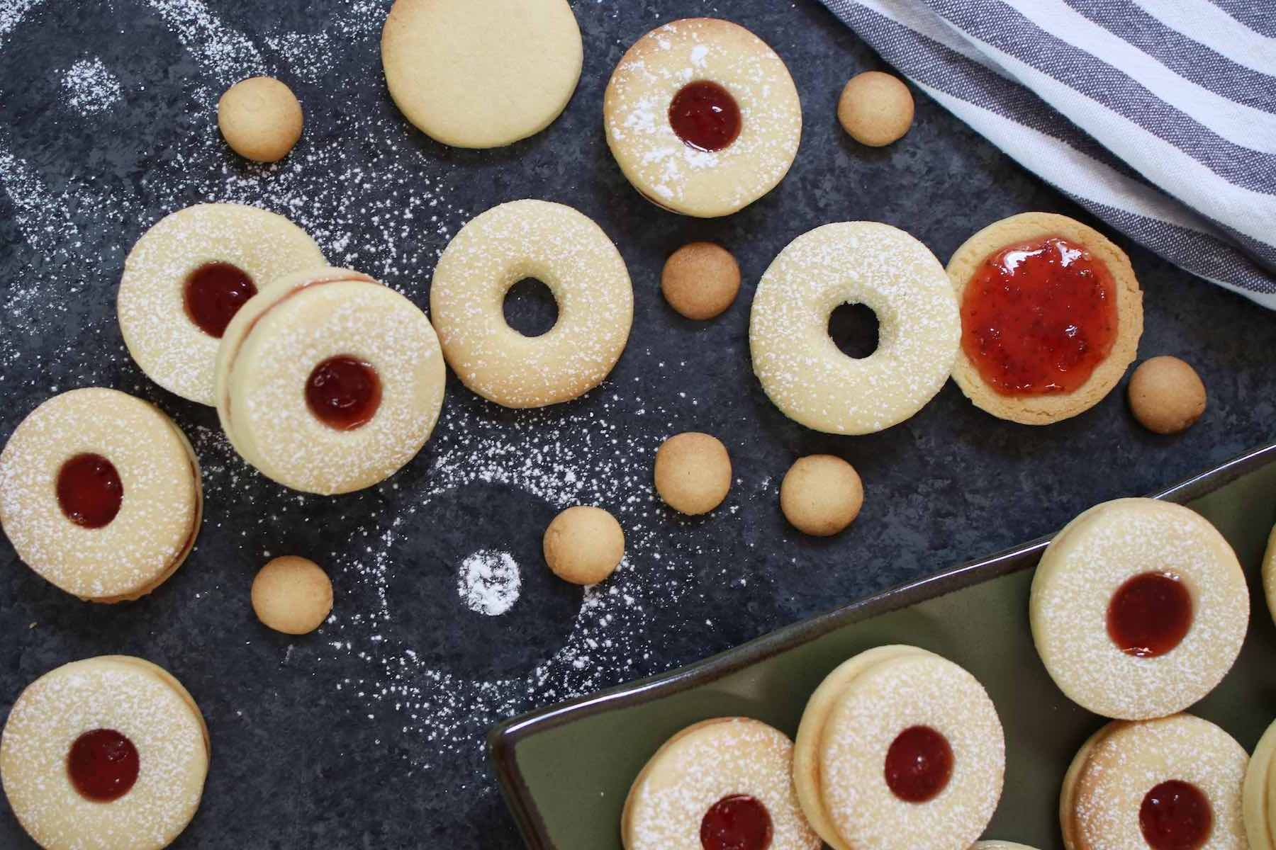 Assembling Jammie Dodgers after the top layers were dusted with icing sugar.
