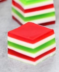 Easy Layered Jello Shots – An easy and beautiful dessert spiked with vodka for a special party! Smooth and creamy Jello shots with bright red, green and white layers. All you need is a few simple ingredients: gelatin, strawberry and lime jello powder, vodka and condensed milk. So Good! Great for holiday and birthday parties. Easy recipe, party desserts. Finger food. No Bake. Vegetarian. Video recipe.