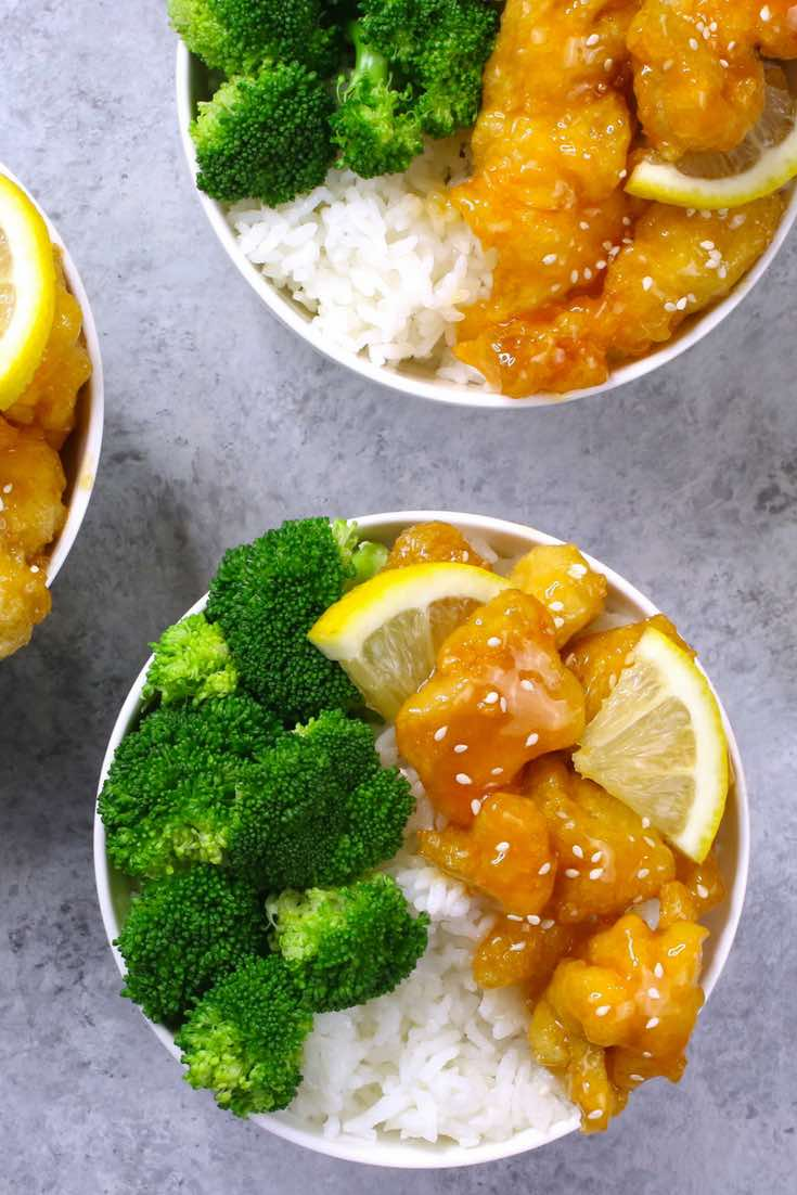The easiest, crispy and most unbelievably delicious Lemon Chicken with Rice Bowls. So much better than take outs! All you need is only a few ingredients: chicken breast, lemon, salt & pepper, egg, oil, sugar, and cornstarch. One of the best Asian dinner ideas! Served with rice and broccoli. Quick and easy dinner recipe. Video recipe. | Tipbuzz.com