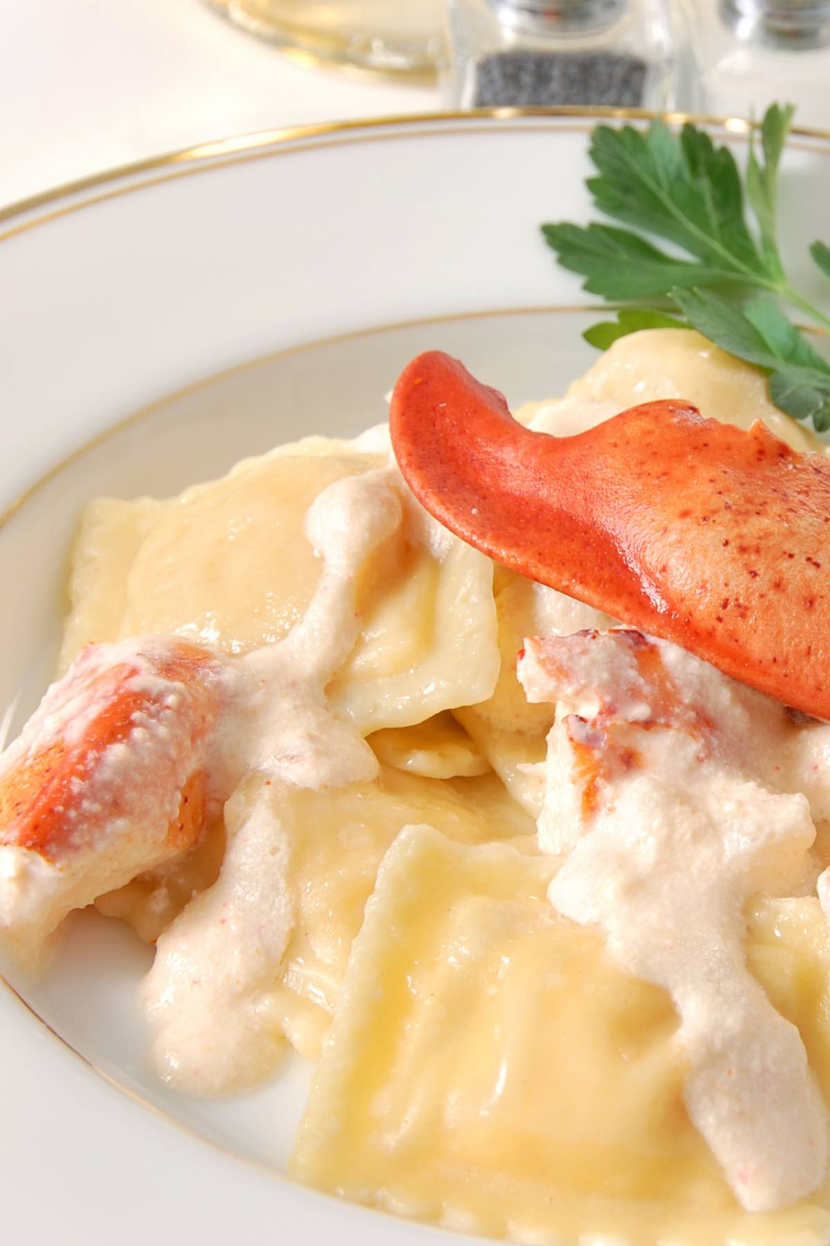 Closeup of lobster ravioli sauce made with butter, cream and white wine