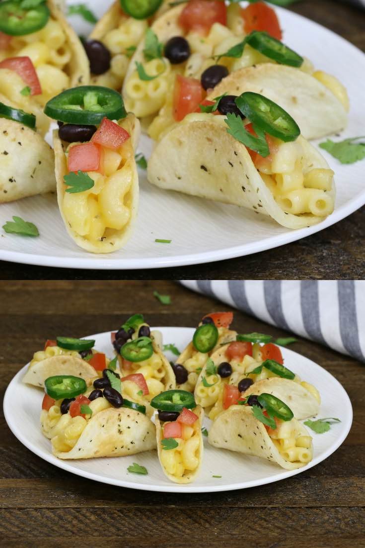 Mac and cheese taco shells topped with sliced jalapeno, diced tomatoes and sliced olives