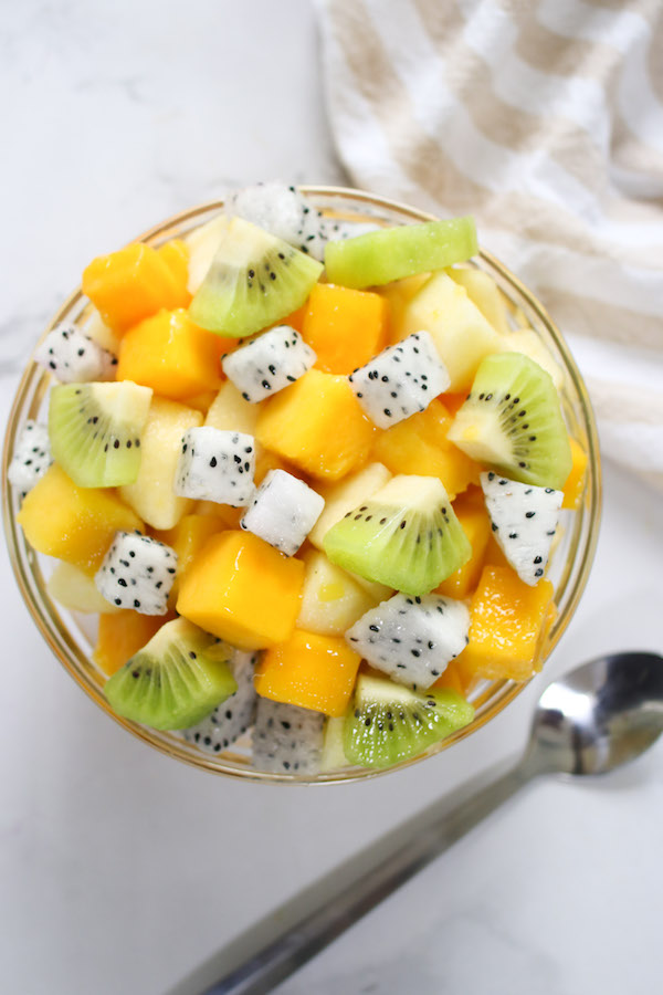 A fresh fruit salad is an easy way to use cut mango. This bowl of salad features cubes of mango with kiwi, dragon fruit and pineapple