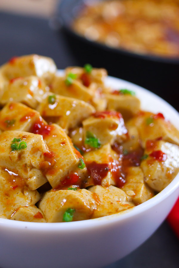 Mapo Tofu closeup showing minced pork, fresh red chilis and green onion