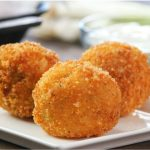 Fried Mashed Potato Balls make a delicious appetizer for a party or just a comforting snack, and they're perfect for using up leftover mashed potatoes. Crispy on the outside and soft on the inside. So good! Video recipe. Tipbuzz.com