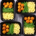 This meatball meal prep features BBQ meatballs with cooked pasta and green beans
