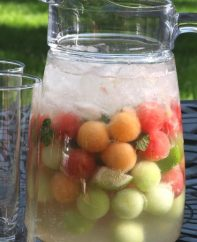 Easy Melon Ball Mojitos – the classic mojito cocktail fused with the sweetness and freshness of melon balls, delivering this refreshing and beautiful drink. All you need is only a few ingredients: mint, watermelon, cantaloupe and honeydew melons, white rum, sugar, lime, ice and sparkling water. Easy drinks recipe. Video recipe. | Tipbuzz.com