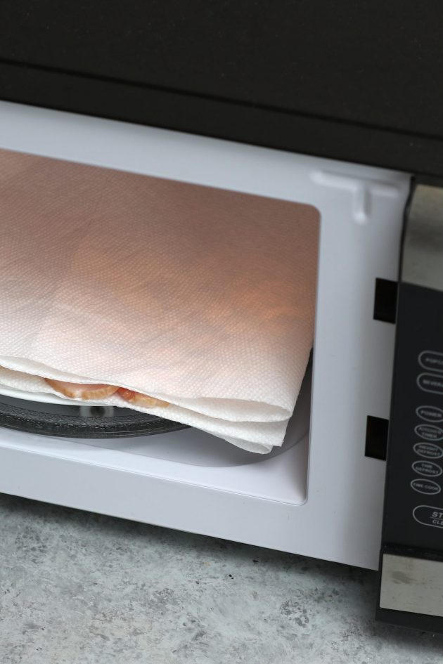 Placing a paper towel lined plate into a small microwave
