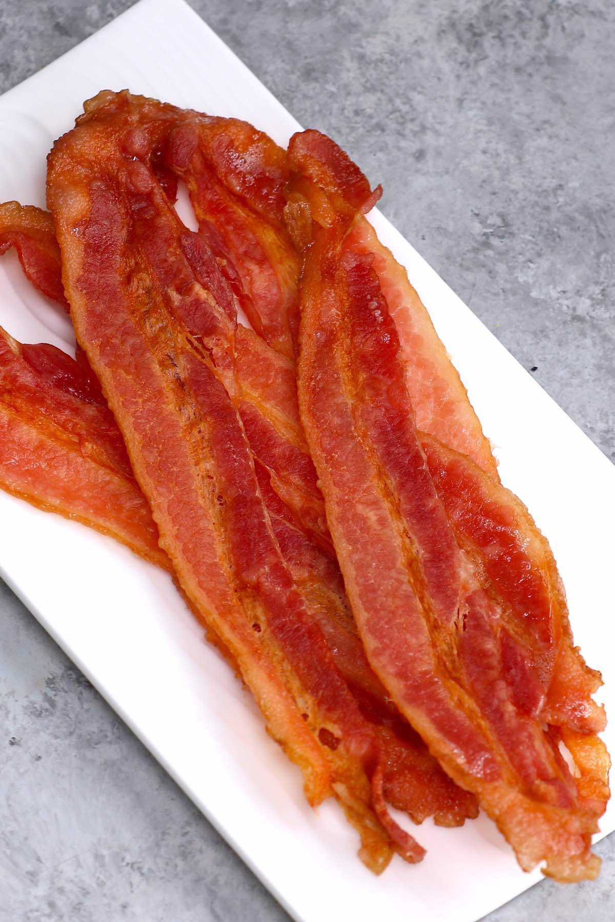 Strips of crispy microwaved bacon on a serving plate #microwavebacon