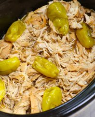 Mississippi Chicken in the crock pot after being slow cooked and shredded