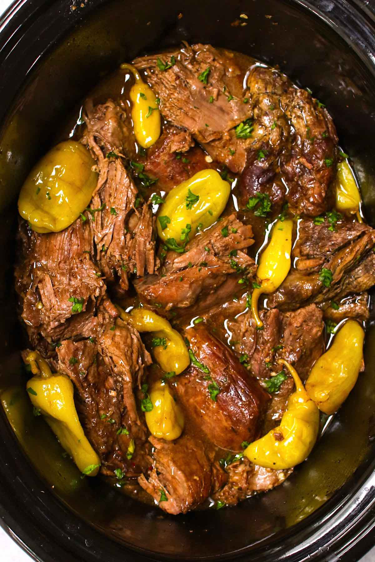 Fork tender cooked Mississippi pot roast in a slow cooker