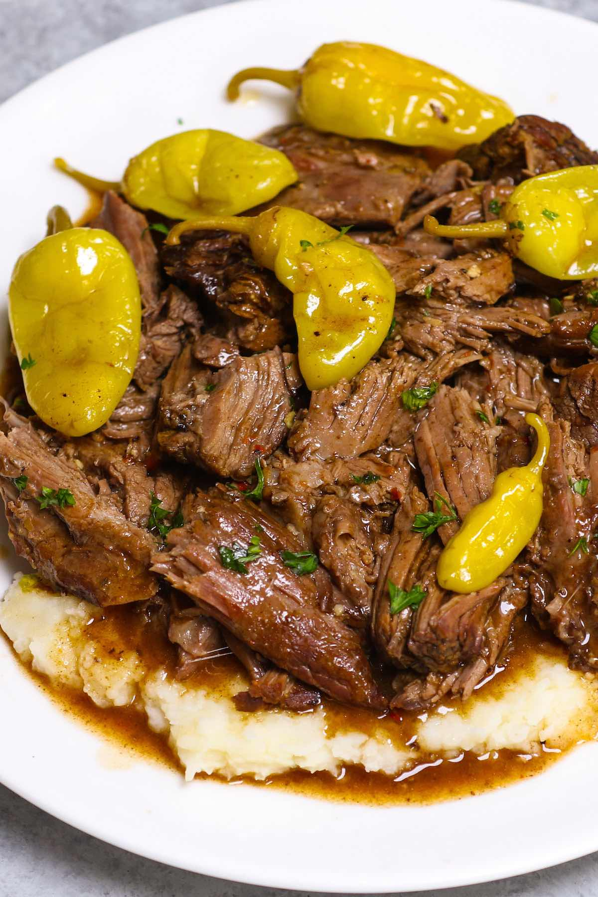 """Mississippi Pot Roast is a fork-tender chuck roast that's full of flavor! This no-fuss """"dump and go"""" pot roast recipe is made with 5 ingredients in a crockpot with only 10 minutes of prep!"""