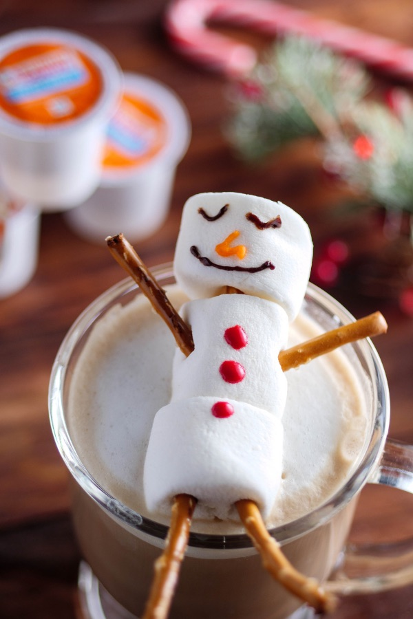 Snowman Mocha Lattes are a festive hot drink to share with family and friends during the holiday season, made with marshmallows, pretzels, cocoa, Dunkin' Donuts coffee and steamed milk