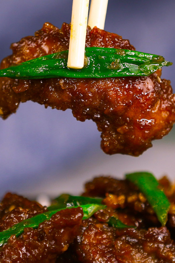 Tender and juicy beef smothered in an addictive sticky, slightly sweet and savory ginger garlic sauce. Mongolian Beef is a popular P.F Chang's menu item and crowd favorite Chinese dish that's ready in 20 minutes. Plus recipe video tutorial!