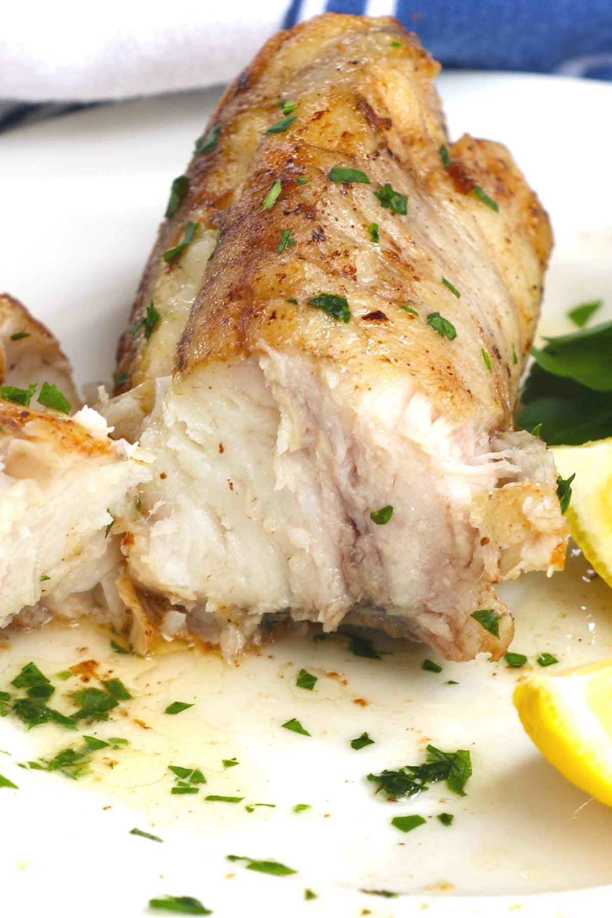 Closeup of perfectly cooked monkfish showing the firm texture