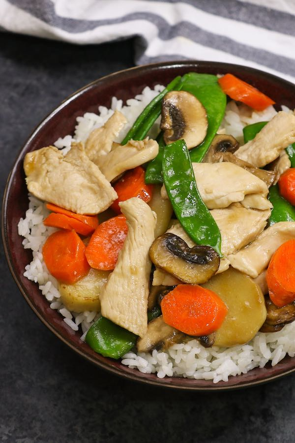 This Moo Goo Gai Pan is a quick and easy Chinese stir fry featuring sliced chicken breast, mushrooms, water chestnuts and vegetables served in rice bowls. It's a healthy and attractive weeknight dinner idea that's quick and easy to make.