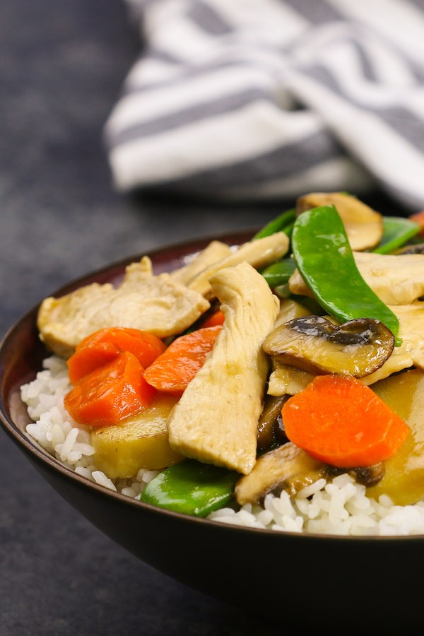 Closeup of Moo Goo Gai Pan served in rice bowls for an attractive presentation of this healthy Chinese dish