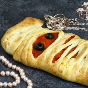 This photo shows a homemade Mummy Pizza that's perfect to make for a Halloween party