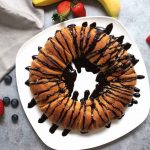 Nutella Banana Crescent Ring – you can't resist this delicious chocolate banana dessert! All you need is four simple ingredients: bananas, Nutella, crescent roll dough and cinnamon. It's great for a party or cheat day. So yummy! Vegetarian. | tipbuzz.com
