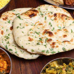 Sourdough naan as part of an Indian meal