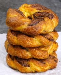 Easy Nutella Crescent Twisted Donuts – A decadent treat that's so easy and beautiful! Roll, cut, twist and shape into donuts! All you need is crescent roll, Nutella, egg and cinnamon sugar. The perfect snack, breakfast or brunch and you will wow your friends! Quick and easy recipe. Party food. Great for a holiday brunch such as Easter, Mother's Day or Father's Day. Vegetarian.