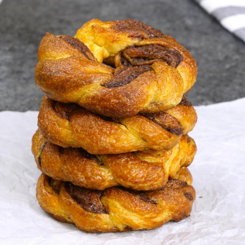 This is a closeup photo of Nutella Crescent Roll Twisted Donuts ready to eat