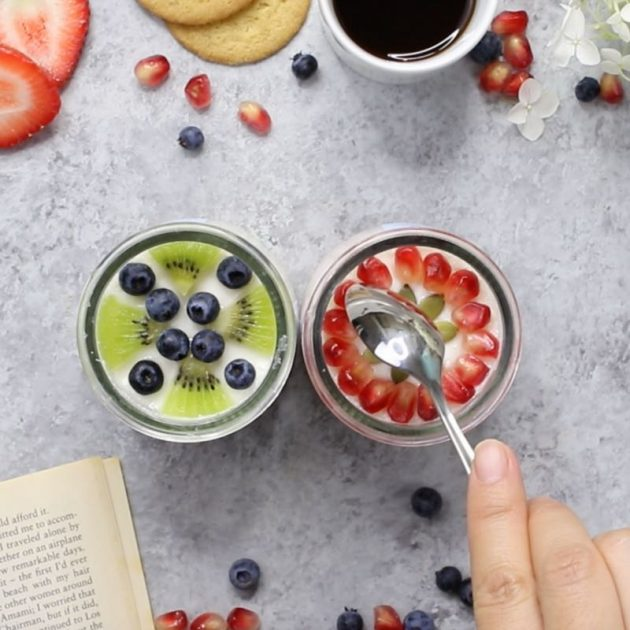 This is a photo of a spoon about to cut into the delicious Oui By Yoplait French-style yogurt and fresh fruits for the perfect break during a busy day