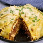 Easy, cheesy party lasagna – A perfect way for a crowd to enjoy the pleasure of lasagna. All you need is a few simple ingredients: lasagna noodles, ground beef, onions, garlic, ricotta cheese, parmesan cheese, mozzarella, oil, egg, tomato and fresh basil for garnish. A perfect dinner for the whole family or a party! Party food. Video recipe. | Tipbuzz.com
