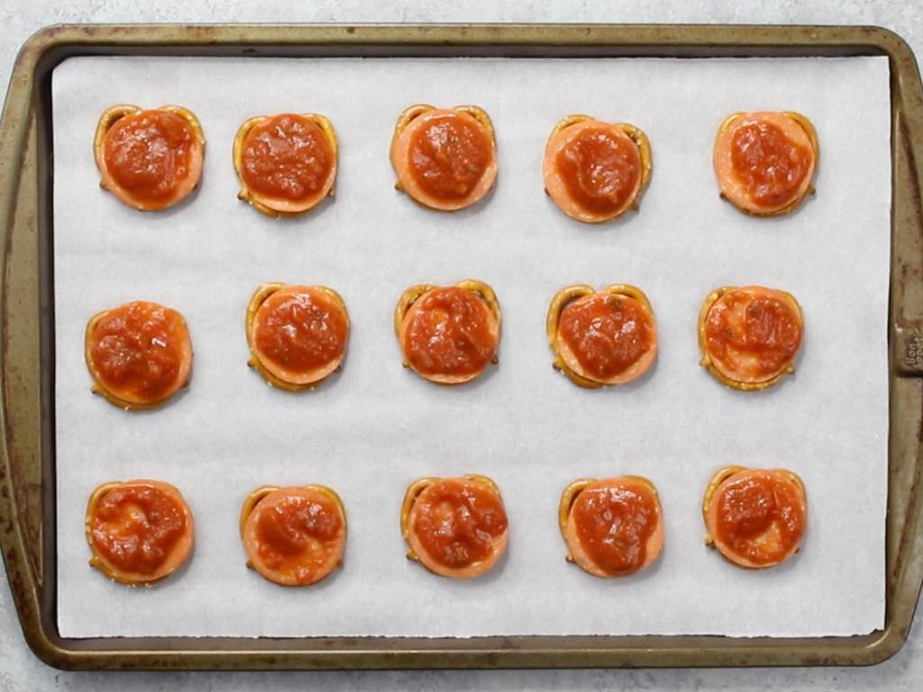 This is a photo of pizza pretzels with sauce on top of the pepperoni