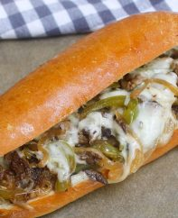 Philly Cheesesteak Recipe is a classic combination of thinly sliced steak and melted cheese in a soft and crusty roll. This philly steak sandwich is easy to make at home and rivals the best philly cheesesteaks in Philadelphia!