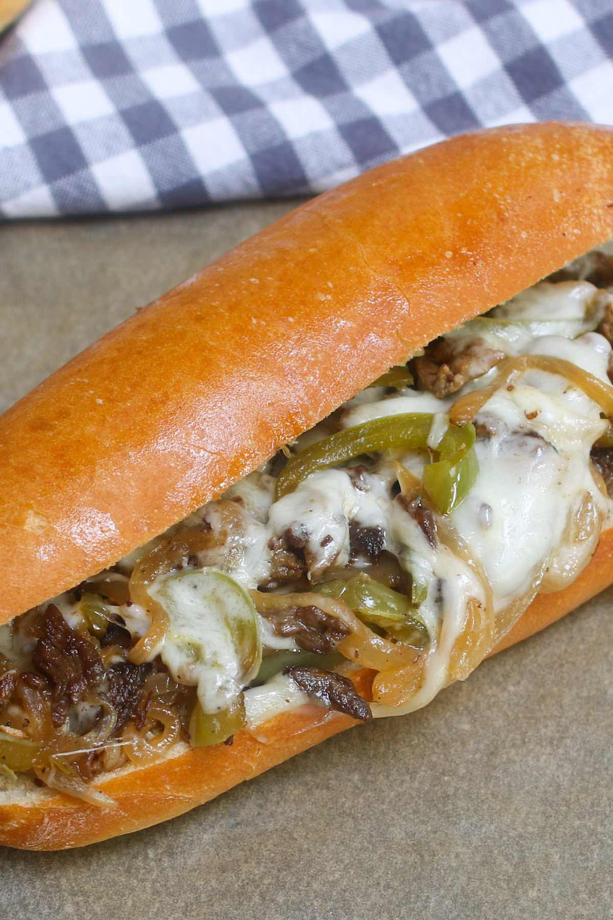 Philly Cheesesteak Recipeis a classic combination of thinly sliced steak and melted cheese in a soft and crusty roll. This philly steak sandwich is easy to make at home and rivals the best philly cheesesteaks in Philadelphia!