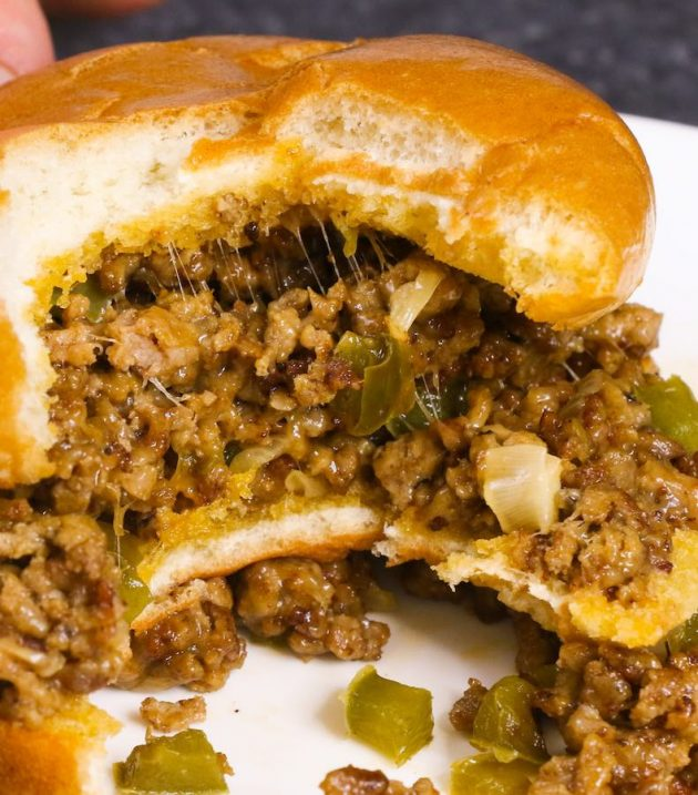 Taking a bite of a Philly Cheesesteak Sloppy Joe