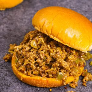The easiest and most unbelievably delicious Philly Cheesesteak Sloppy Joes! And it'll be on your dinner table in just 30 minutes. All you need is only a few simple ingredients: ground beef, beef broth, Worcestershire sauce, catchup, cornstarch and hamburger buns. Quick and easy dinner or lunch recipe. Video recipe. | Tipbuzz.com #SloppyJoes #PhillyCheeseSteak