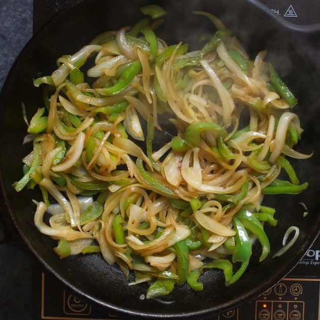 1. Sauté bell onions and bell peppers in the skillet.