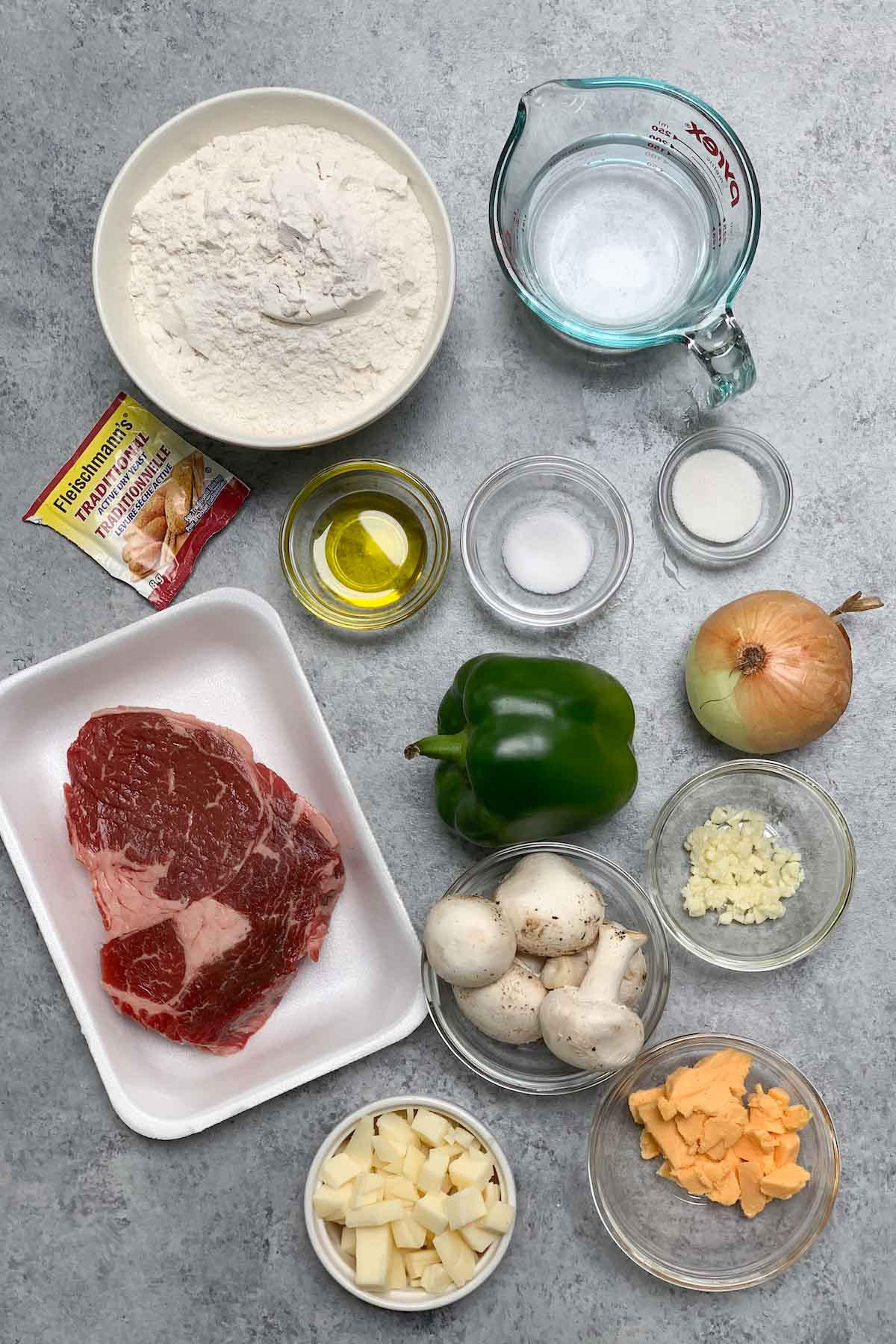 Ingredients for making homemade Domino's Philly Cheese Steak Pizza